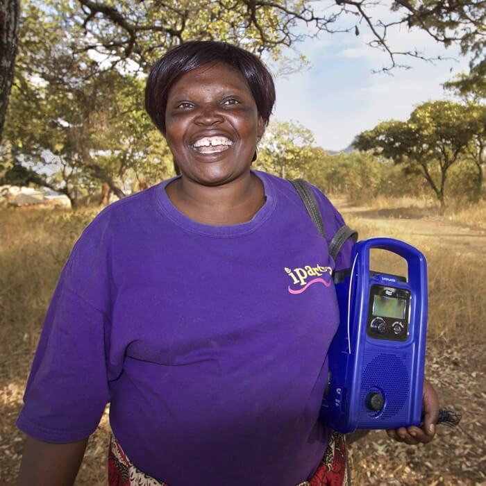 African woman with a radio
